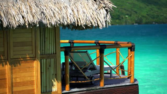 luxury overwater bungalow balcony aquamarine lagoon bora bora - polynesian ethnicity stock videos & royalty-free footage