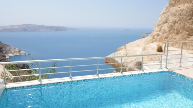 luxury poolside with gazebo & santorini - gazebo stock videos & royalty-free footage