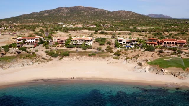 luxury real estate on beach in cabo san lucas - cabo san lucas stock videos & royalty-free footage