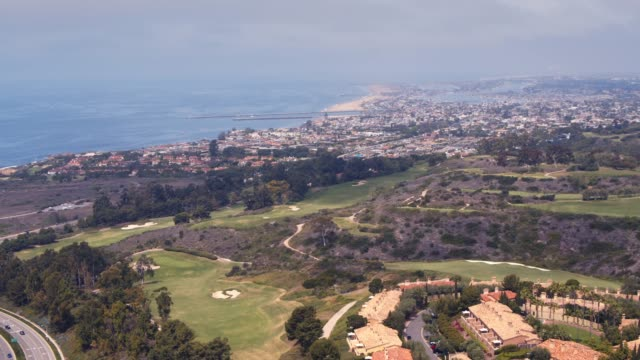 luxury resort on pelican hill in newport beach aerial - tourist resort stock videos & royalty-free footage