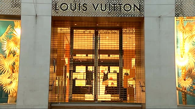 0f269cd66818 London New Bond Street EXT  Louis Vuitton  sign at shop entrance   VL flag