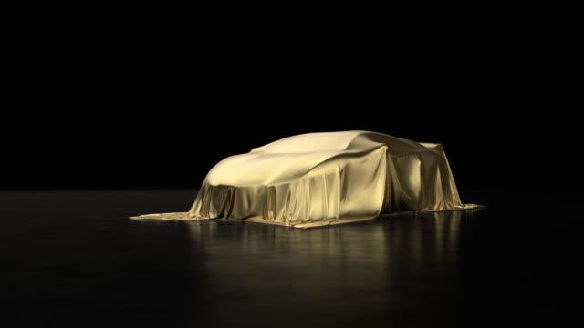 luxus-sportwagen mit goldstoff bedeckt. - preisverleihung stock-videos und b-roll-filmmaterial