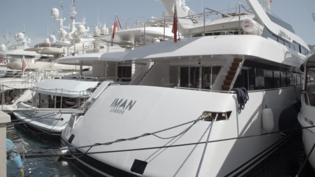 stockvideo's en b-roll-footage met luxury super yachts in the harbour / monte carlo, monaco - aangelegd