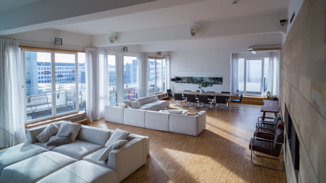 luxury, urban, spacious city loft - day to night to day time lapse - living room stock videos & royalty-free footage