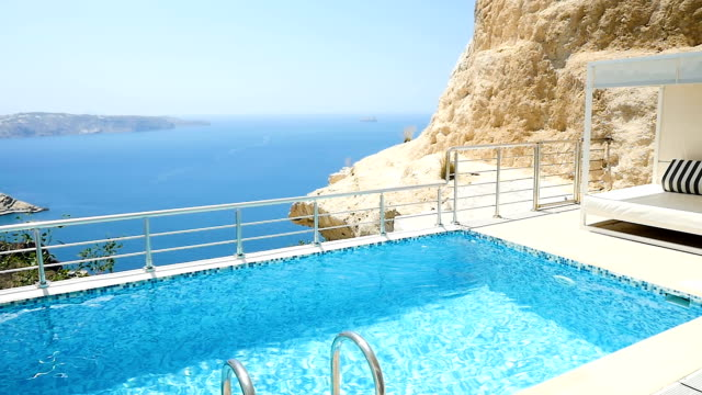 luxury vacations & resort santorini - poolside stock videos & royalty-free footage