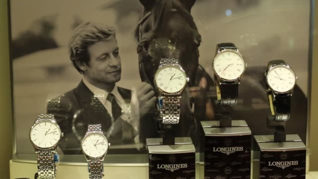 vídeos y material grabado en eventos de stock de luxury wristwatches manufactured by cie des montres longines francillon sa sit on display inside the sublime by bosco di ciliegi retail unit at the... - reloj de pulsera