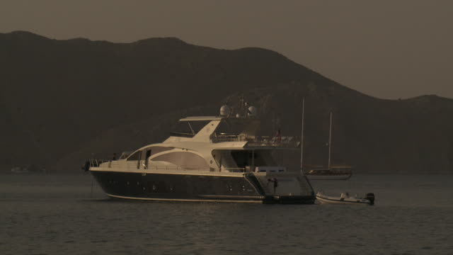luxury yacht anchored at symi harbour - rhodes dodecanese islands stock videos & royalty-free footage