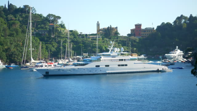 a luxury yacht anchored in a resort town in italy, europe. - slow motion - zeus stock videos and b-roll footage