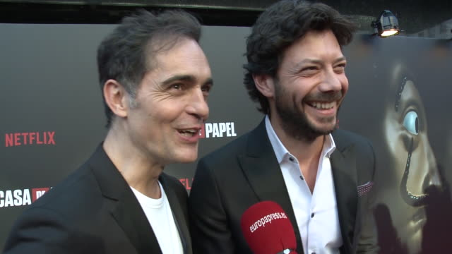 álvaro morte and pedro alonso, money heist serie protagonists, talk about their work in season 3 in madrid - television show stock-videos und b-roll-filmmaterial