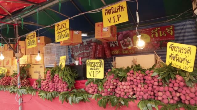 Lychees sit for sale at a roadside stall in Chiang Mai Thailand on Monday May 29 Vendors wait for customers at a roadside stall selling lychees