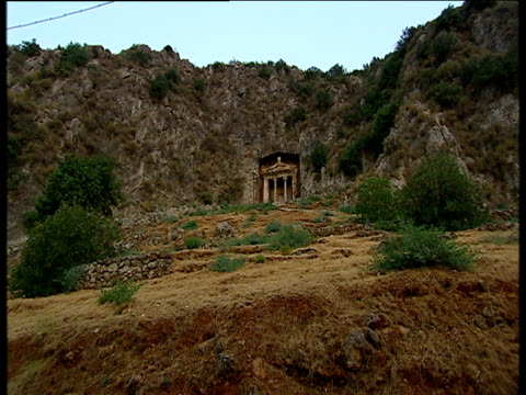lycian rock tombs entrances built into cliff face - rock face stock videos & royalty-free footage
