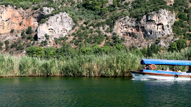 lycian tombs of dalyan with tourist boat passing, dalyan, anatolia, turkey, asia minor, eurasia - eurasia stock videos and b-roll footage