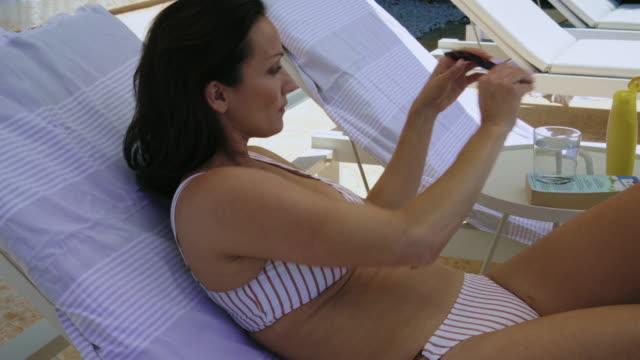 lying on lounge chair - solstol bildbanksvideor och videomaterial från bakom kulisserna