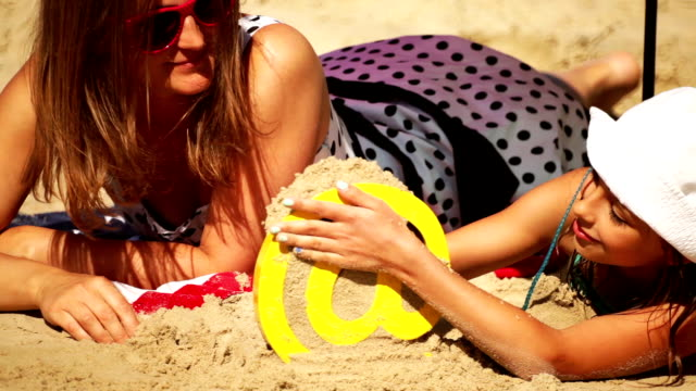 lying on the sand - 'at' symbol stock videos and b-roll footage
