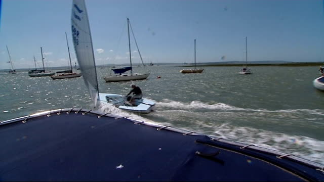 EXT Reporter and Ainslie pushing boat out of boat yard Ainslie sailing on The Solent Ben Ainslie interview SOT saying it's good day for sailing /...