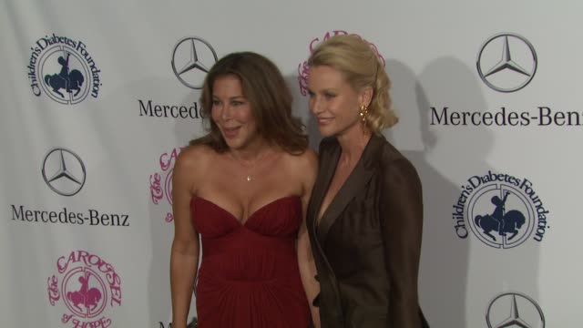 lyndie benson-gorelick, nicollette sheridan at 26th anniversary carousel of hope ball on in beverly hills, ca. - ニコレット シェリダン点の映像素材/bロール