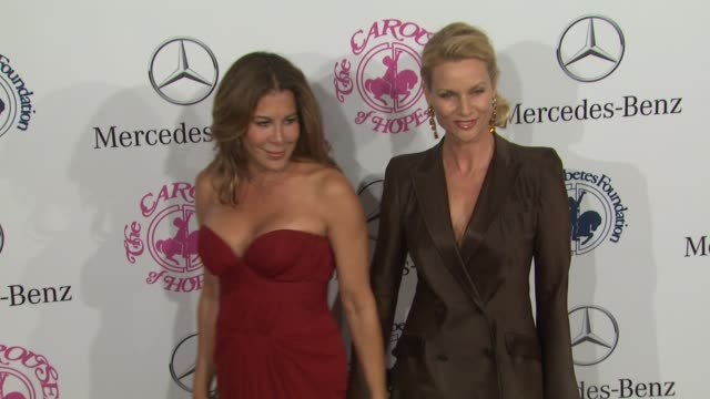 vídeos de stock e filmes b-roll de lyndie bensongorelick nicollette sheridan at 26th anniversary carousel of hope ball on in beverly hills ca - nicollette sheridan