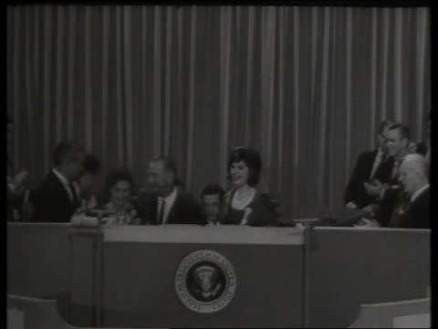 vídeos de stock e filmes b-roll de b/w lyndon johnson with family at convention podium / 1960's / sound - primeira dama