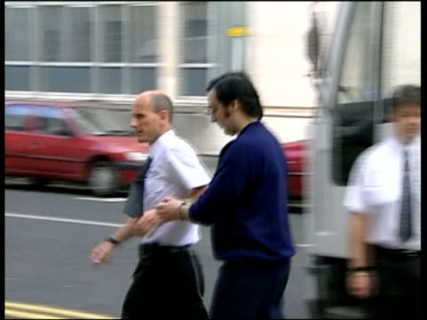 evidence leads to conviction; htv wales: cardiff: ext slow motion jeffrey gafoor led along from prison van to court - vangen stock-videos und b-roll-filmmaterial