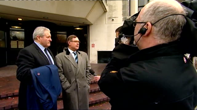 police corruption trial collapses; graham mouncher towards richard powell along speaking into mobile phone press filming thomas page thomas page... - itv news at ten点の映像素材/bロール