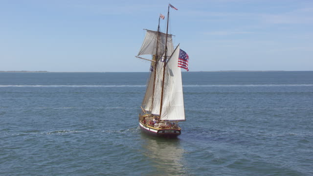 ws zi aerial pov lynx tall ship moving in sea / nantucket, massachusetts, united states - sail stock videos and b-roll footage