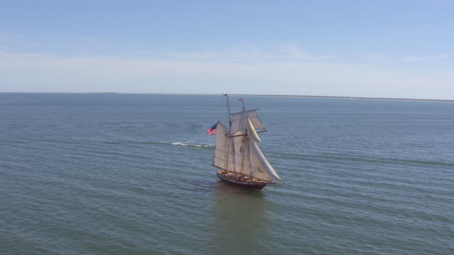 ws aerial pov lynx tall ship moving in sea / nantucket, massachusetts, united states - sail stock videos and b-roll footage