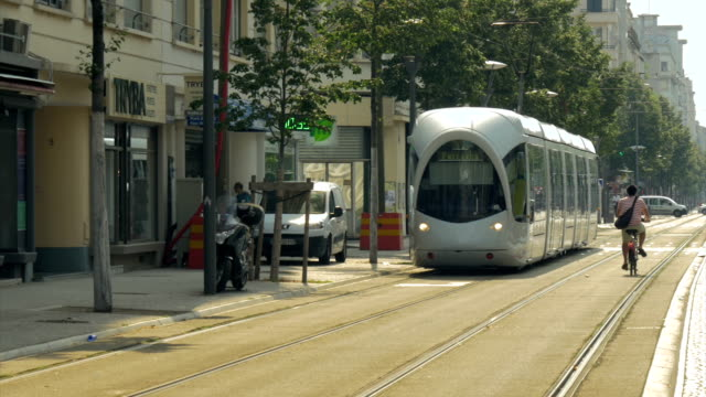 lyon, train, trams,cyclist ms - tram stock videos & royalty-free footage