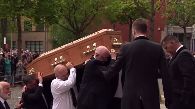 politicians attend funeral of murdered journalist NORTHERN IRELAND Belfast St Anne's Cathedral EXT Coffin of Lyra McKee carried up cathedral steps by...