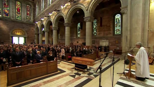 politicians attend funeral of murdered journalist northern ireland belfast st anne's cathedral int stephen lusty speech sot wide shot service leo... - leo varadkar stock videos and b-roll footage