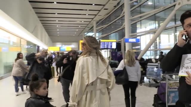 'i'm a celebrity get me out of here' contestants and presenters touch down in the uk at heathrow airport singer nadine coyle greets well wishers and... - i'm a celebrity... get me out of here stock videos & royalty-free footage