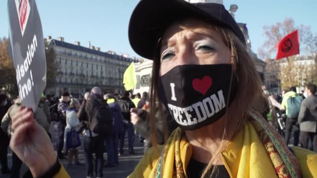 "m here for my freedom,"" says one protester as people take to the streets in paris to demand the government abandon a contentious new security law, a... - law stock videos & royalty-free footage"