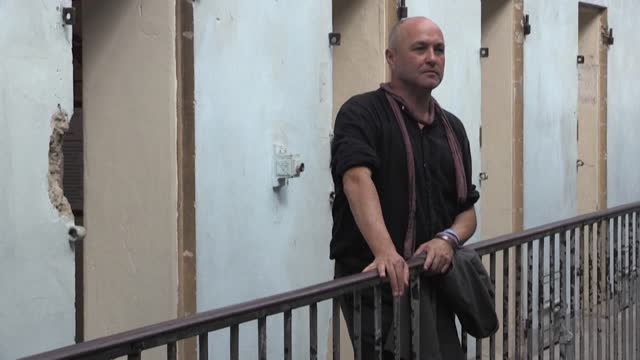 """m sure there are ghosts here,"""" says writer colum mccann as he visits the former montluc prison in lyon, where resistance fighter jean moulin was... - report produced segment stock videos & royalty-free footage"""