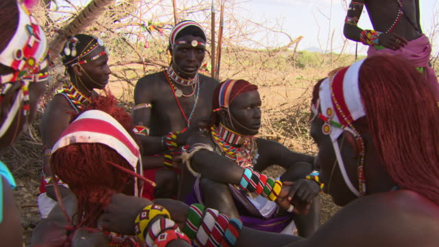 Maasai Ceremony - Group of young warriors dressing their hair, WITH AUDIO