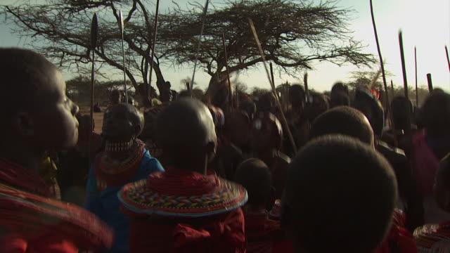 maasai ceremony - warriors and women dancing, with audio - feierliche veranstaltung stock-videos und b-roll-filmmaterial