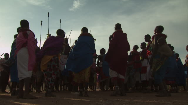 maasai ceremony - warriors dancing, low angle medium shot, with audio - masai stock videos and b-roll footage