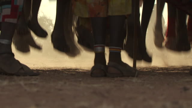 Maasai Ceremony - Warriors dancing, low angle view feet jumping