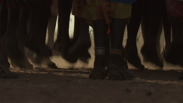 maasai ceremony - warriors dancing, low angle view feet jumping, with audio - masai stock videos and b-roll footage