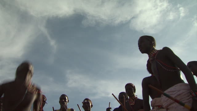 Maasai Ceremony - Warriors jumping up and down, dancing, low angle view