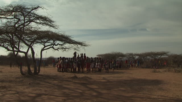 maasai ceremony - warriors jumping up and down, dancing, wide shot group, with audio - masai stock videos and b-roll footage