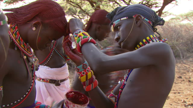 maasai ceremony - young warriors preparing for ceremony, with audio - headdress stock videos and b-roll footage
