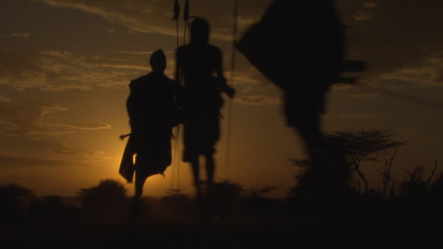 maasai or samburu warriors singing and dancing, silhouetted in sunset, with audio - spirituality stock videos & royalty-free footage