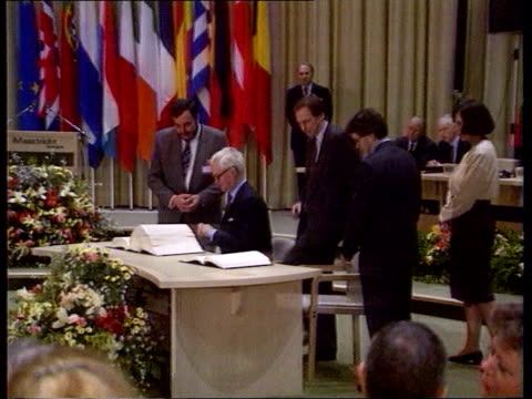 social chapter; tx 7.2.92 itn holland:maastricht side douglas hurd sitting signing maastricht treaty zoom in - douglas hurd stock-videos und b-roll-filmmaterial