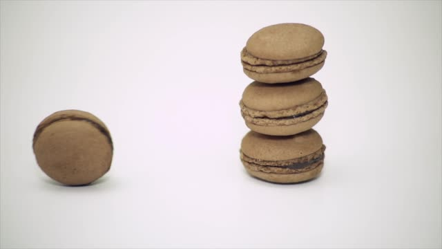 macaron roll slow motion - four objects stock videos & royalty-free footage
