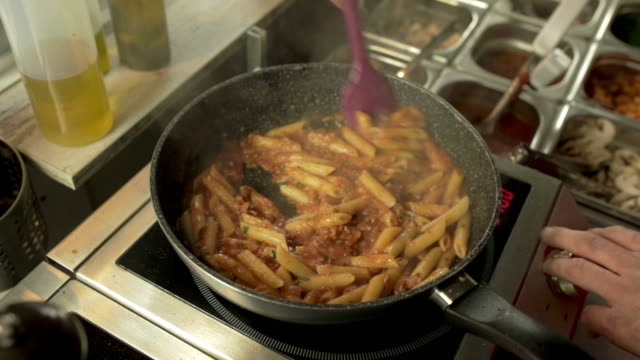 macaroni with bolognese sauce - saute stock videos and b-roll footage