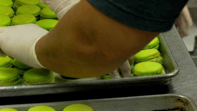 macaroons assembly - macaroon stock videos and b-roll footage