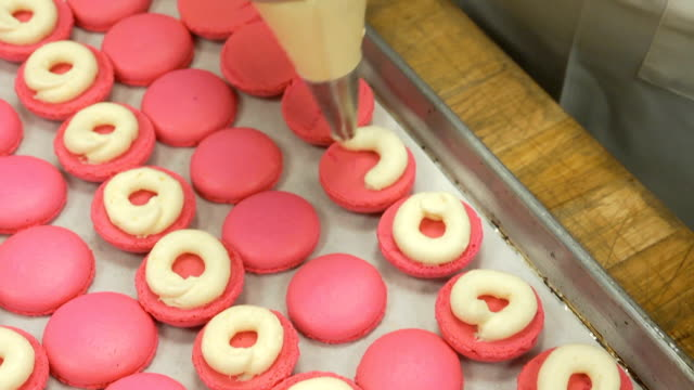macaroons pink dolly - icing stock videos and b-roll footage