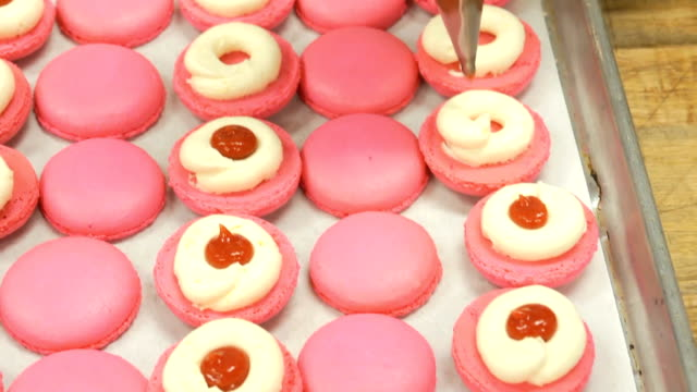 macaroons red filling dolly shot - macaroon stock videos and b-roll footage