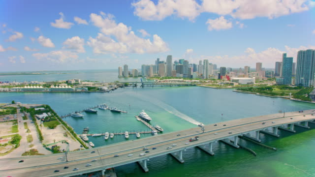 aerial macarthur causeway with downtown miami, fl - marina stock videos & royalty-free footage