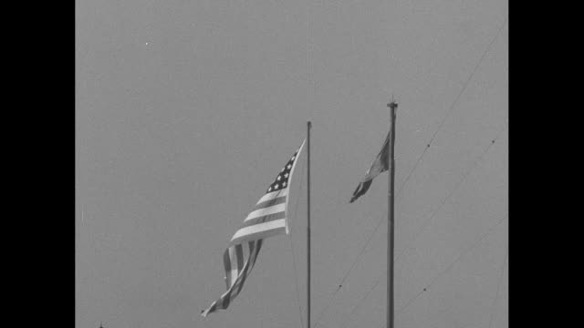 ls macarthurõs headquarters / ls united states and united nations flags fly / ls flags fly / ls general joseph lawton collins united states army... - douglas macarthur stock videos and b-roll footage