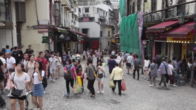 macau , china; september 24, 2016; macao is one of the world's most densely populated spots. a large section of macau peninsula has been designated a... - macao点の映像素材/bロール